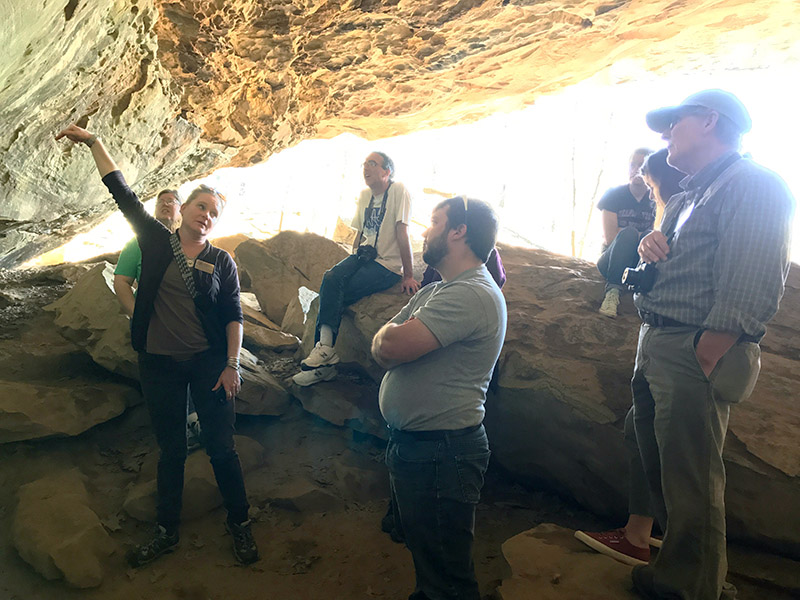 Dr. Horton showing the teacher workshop participants rock art depicting plants on the walls of Rockhouse Cave.