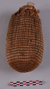 This woven bag made from rattlesnake master leaves and pawpaw bark was recovered from a bluff shelter in Benton County in the 1930s. There were thousands of seeds from a domesticated version of the goosefoot plant inside the bag. Radiocarbon dating of the seeds shows that Arkansas Indians were growing, tending, and harvesting this now extinct crop at AD 20. Photograph by David Dye, 2015.