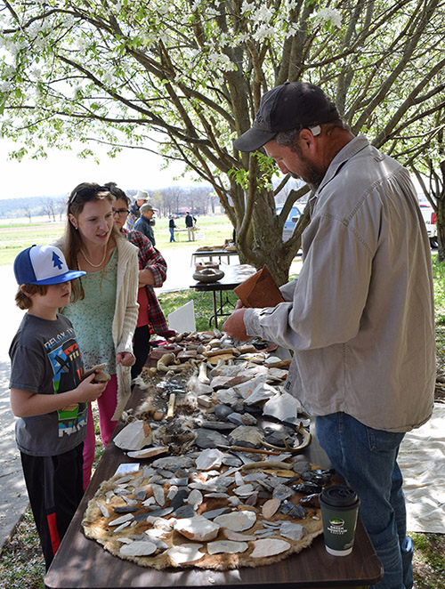 UAF Station Assistant Mike Evans demonstrating flint knapping during Archeology Day 2016 in Fayetteville.