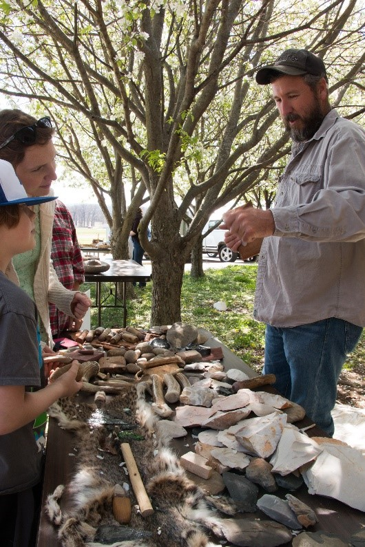 Mike Evans demonstrates replica Native american tools during Archeology Day 2016 in Fayetteville.