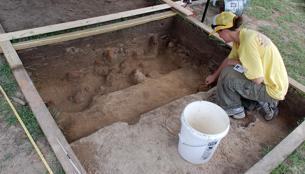 Arkansas Archeological Society member and UA graduate student Michelle Rathgaber excavating at Historic Washington State park