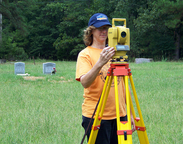 Dr. Mary Beth Trubitt mapping the Helms Cemetery in 2010.