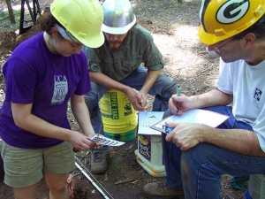 Field crewmembers documenting soil colors at the 2013 Society Training Program.