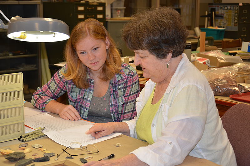 State Archeologist Dr. Ann Early providing cataloging instruction to volunteer Leanda Gavin.
