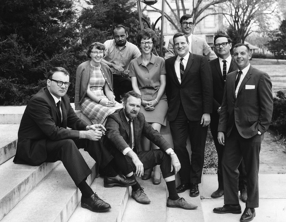 The Arkansas Archeological Survey's founders and first station archeologists in 1968. From left to right: Frank Schambach, Hester Davis, Burney McClurkan (top), Jim Scholtz (sitting), Martha Rolingson, Bob McGimsey, Ken Cole (above Bob), Dan Morse, and John Huner.