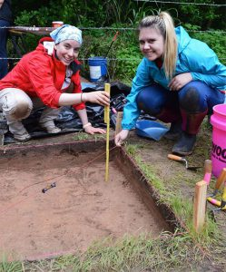 Dr. Carol Colannino teaching 4-H youth how to excavate.