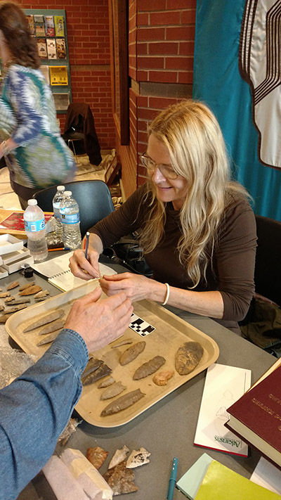 Julie Morrow (ARAS-ASU) combines helping visitors with recording data at an Artifact ID event for the public.