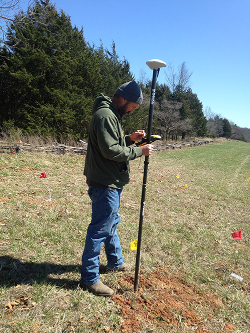 Michael Evans (ARAS-SRP) during geophysical survey at Pea Ridge National Military Park as part of the CESU project in cooperation with the National Park Service Midwest Archeological Center. Photo by Jamie Brandon.