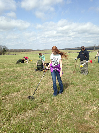 Volunteer Audrey Lindsey learning to use the metal detector in the service of science at Pea Ridge National Military Park. Photo by Jamie Brandon.