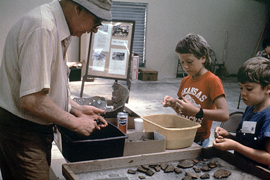 Society members John Jensen, Brandon Holder and Paul Russell in the lab washing artifacts during the 1986 dig.