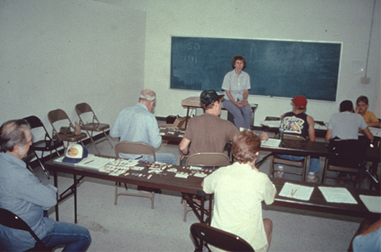 Station archeologist Martha Rolingson teaching a lithics seminar. The 12 seminars offered in the training curriculum are a mixture of classroom lectures and hands-on experience.