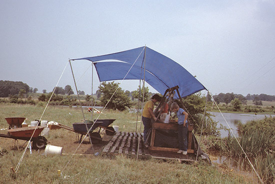 Water screening at Holman Springs during the 1986 Society dig.