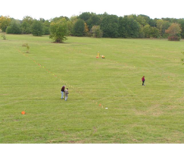 ARAS/OAS team conducting a gradiometer survey at Spiro.