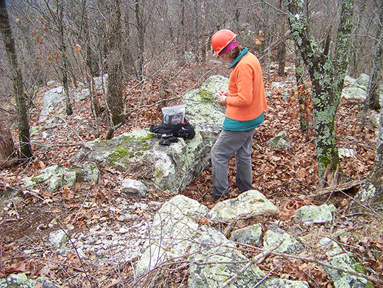 Trubitt documents a quarried trench feature during a visit to a novaculite quarry site in the Ouachita National Forest in 2013.