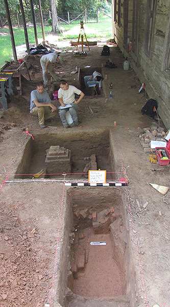 Dr. Emily Beahm and Devin Pettigrew mapping a unit profile while investigating a cellar at Hollywood Plantation in Drew County, 2014