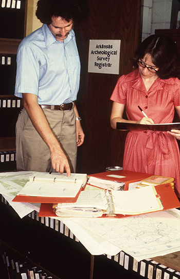 Tim Klinger and Cathy Moore-Jansen (Survey Registrar) look at paper site files in 1979. Major projects can involve over 1,000 sites, making this process laborious if using paper forms. The development of AMASDA allows such projects to be conducted more efficiently.