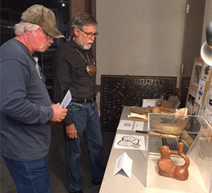 Jim Rees shares information on prehistoric musical instruments at the University of Arkansas curation facility in Fayetteville. . Photo by Marilyn Knapp.