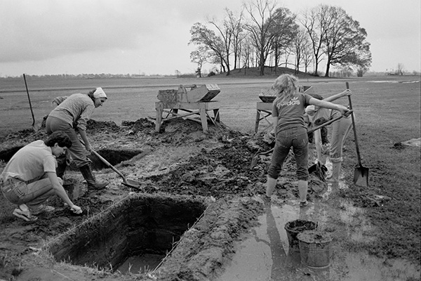 Early excavations at Toltec Mounds. Dr. Martha Rolingson is pictured on the left.