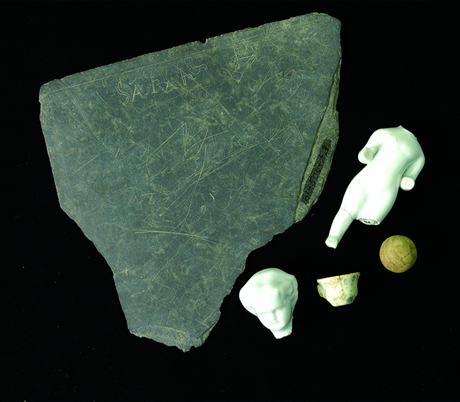 Slate fragment and toys from the Sanders House excavations at Historic Washington Arkansas State Park.