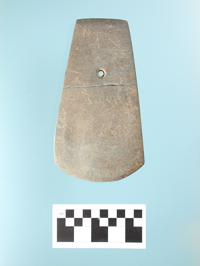 Perforated celt from Prairie County, obverse face.