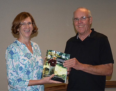 RS67 volume editor Mary Beth Trubitt with ARAS Director emeritus Tom Green.