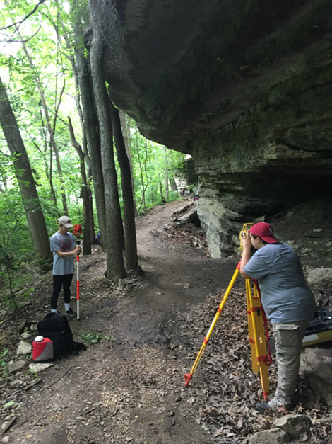 UA graduate student Victoria Jones and undergraduate Jamie Middleton mapping Walker Shelter.