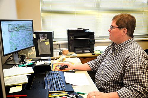 Assistant registrar Teka McGlothlin entering project data into AMASDA.