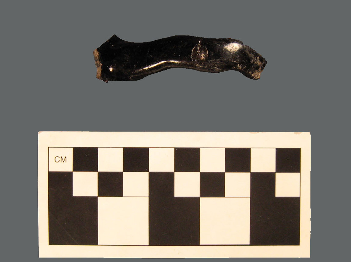 This Jackfield ware teapot handle is typical of the gnarled, tree-branch-shaped handles and spouts, called crabstick, that are found on some eighteenth-century Staffordshire tea and coffee wares (Nöel-Hume 1969: Figure 1.29).