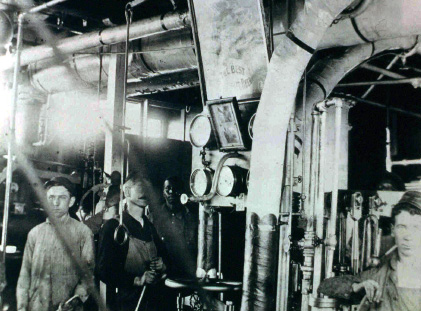Photo of similar steam gauges in use in an engine room.