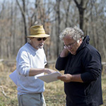 Photo NWA Democrat-Gazette/JASON IVESTER - Jami Lockhart (left) with the Arkansas Archeological Survey and Steven De Vore, archeologist with the National Park Service, look over maps of the area of the Leetown hamlet March 23 at the Pea Ridge Military National Park.
