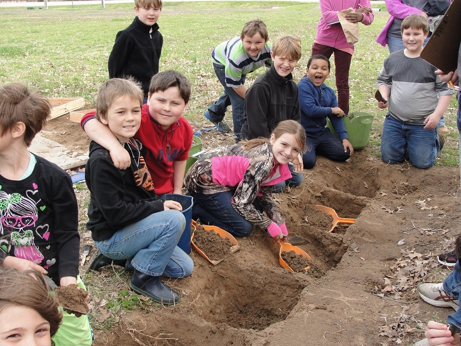 School children dig in to Archeology Month 2016