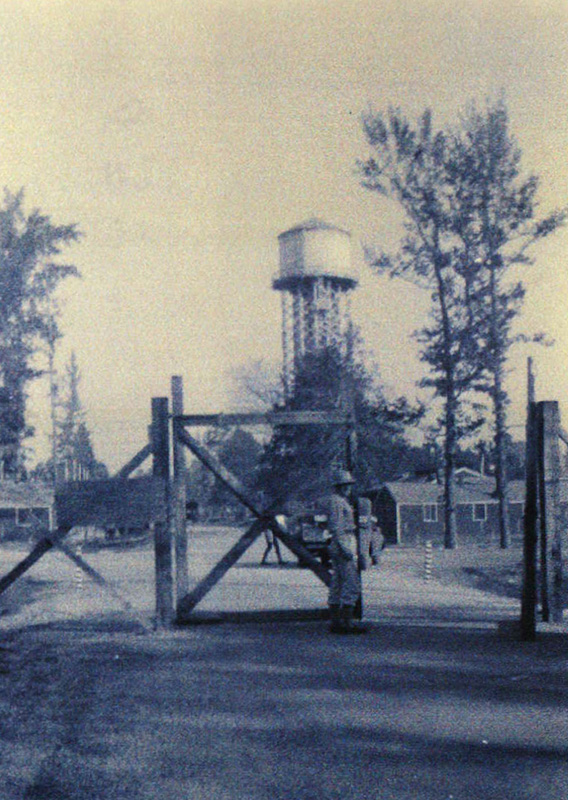 Entrance to the Officer's Compound at Camp Monticello with the water tower in the background (photograph courtesy of Pat Globes Carter).