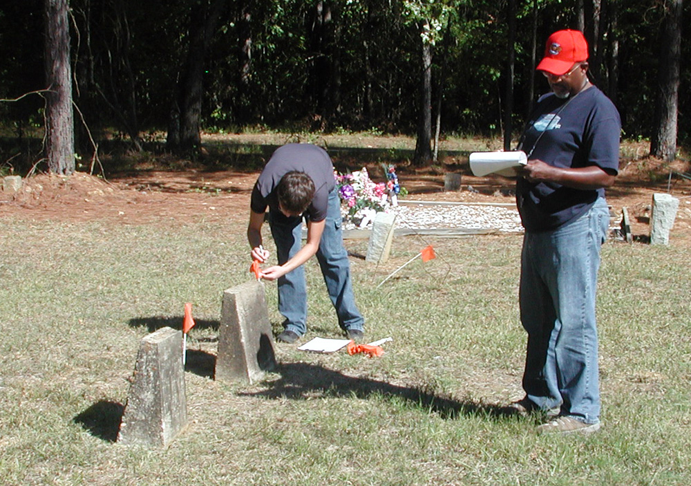 Volunteers assisted with cemetery documentation.
