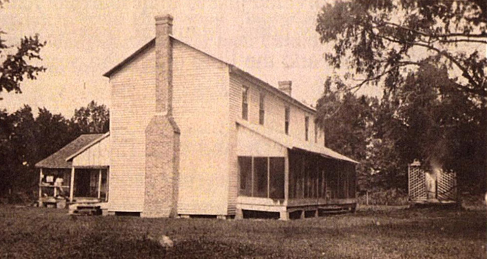 Taylor House with ell kitchen in back. Date unknown. Photo courtesy of UAM Library, Special Collections.