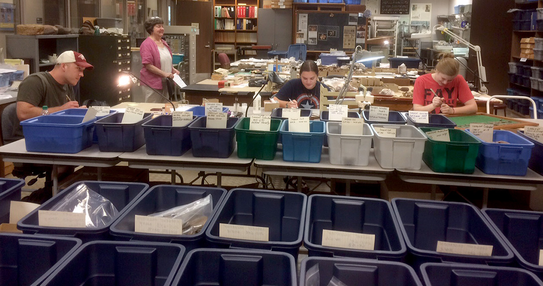 Leanda Gavin (right) and University of Arkansas students Chris Bryant and Katie Sargent were among the two dozen volunteers helping to catalog the Sargent collection.