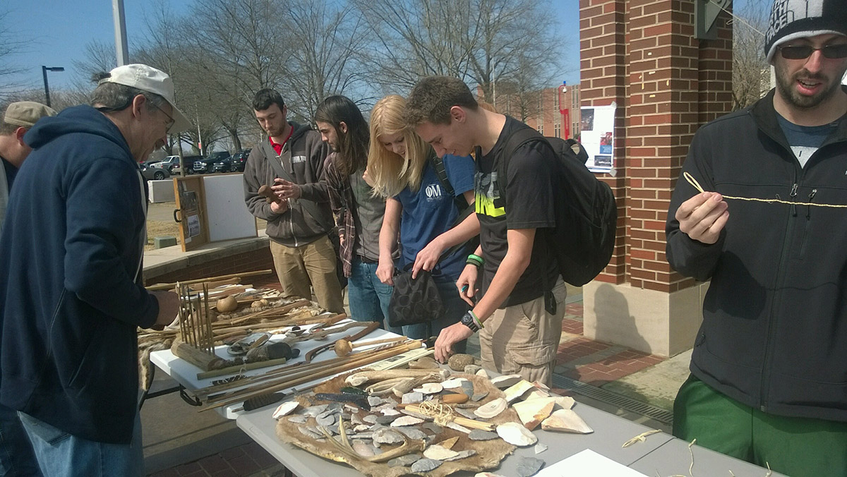 Arkansas Tech University students examine artifact replicas at Archeology Day 2016 in Russellville. The event was hosted by ARAS-WRI station archeologist Dr. Emily Beahm and the Arkansas Tech Anthropology Club.