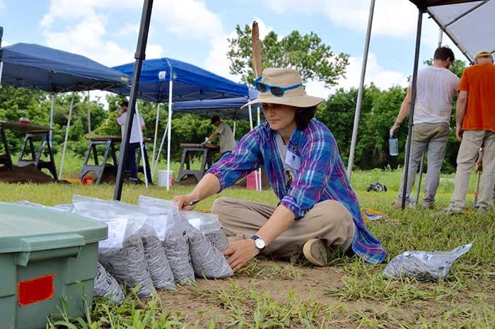 HSU Survey Station Assistant, Katie Leslie, double checks artifact bags.