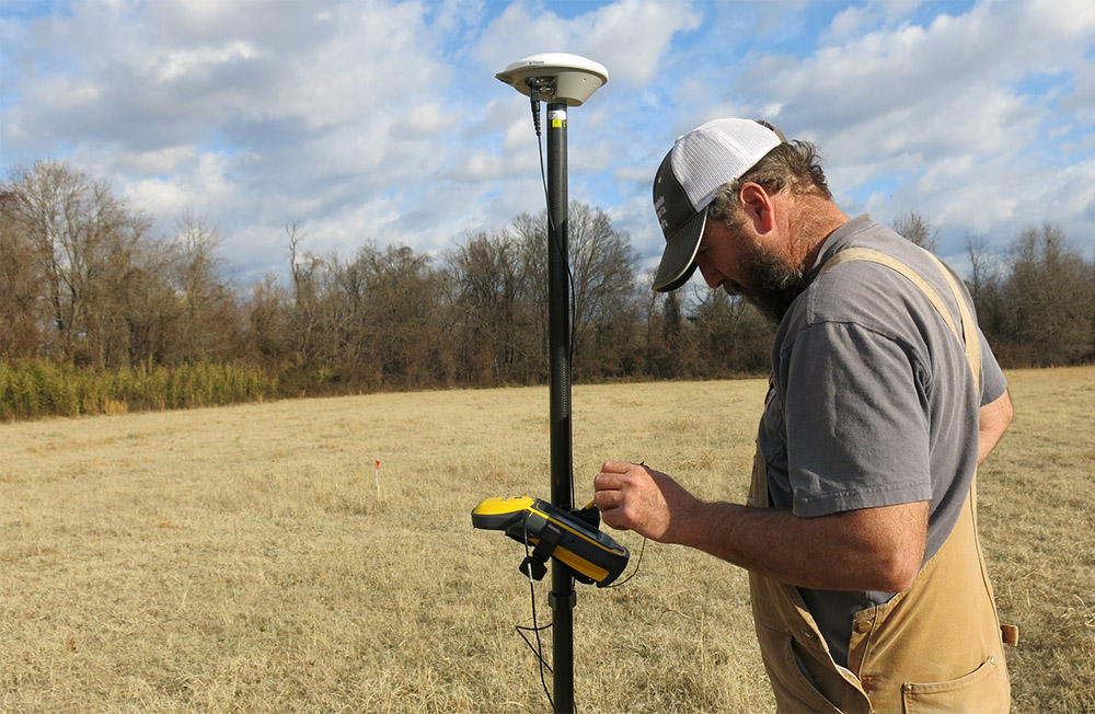 Michael Evans using the Trimble Geo7X to georeference the grid.