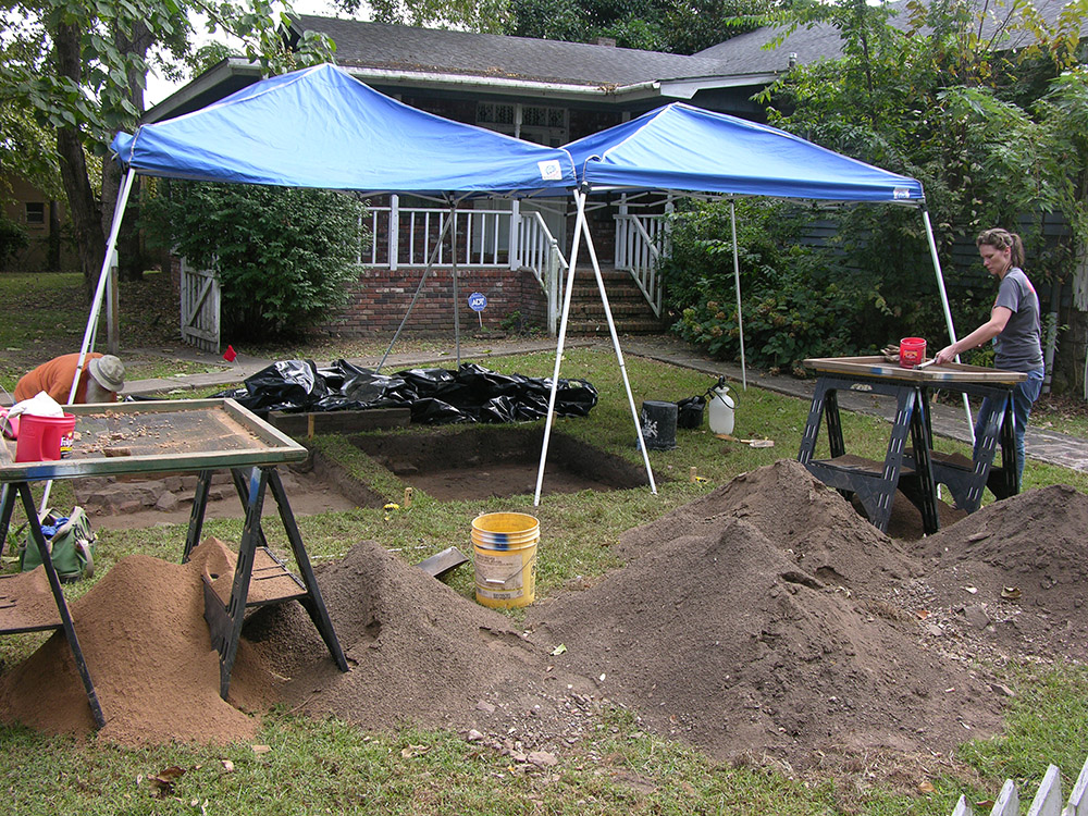 Larry Porter and Anna Vincent excavating in the cellar area.