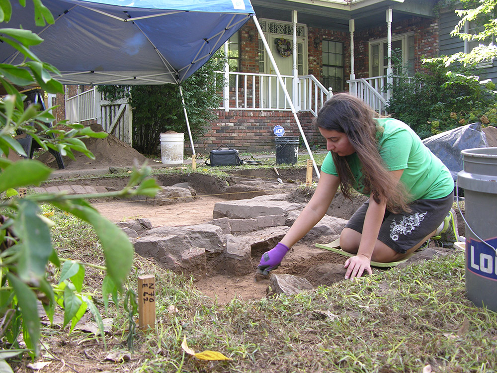 Volunteer Melinda Martin excavating at the Willhaf house.