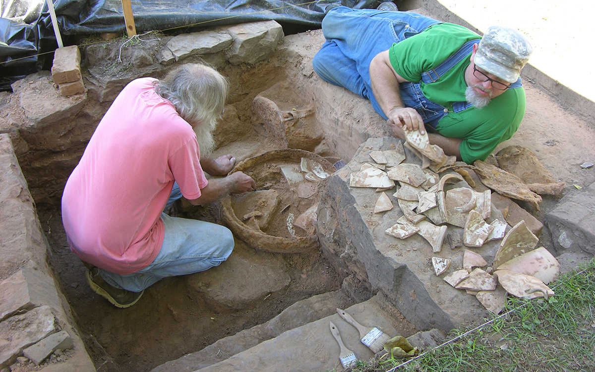 Survey archeologists Larry Porter and Jared Pebworth excavating the cellar steps at the Willhaf house.