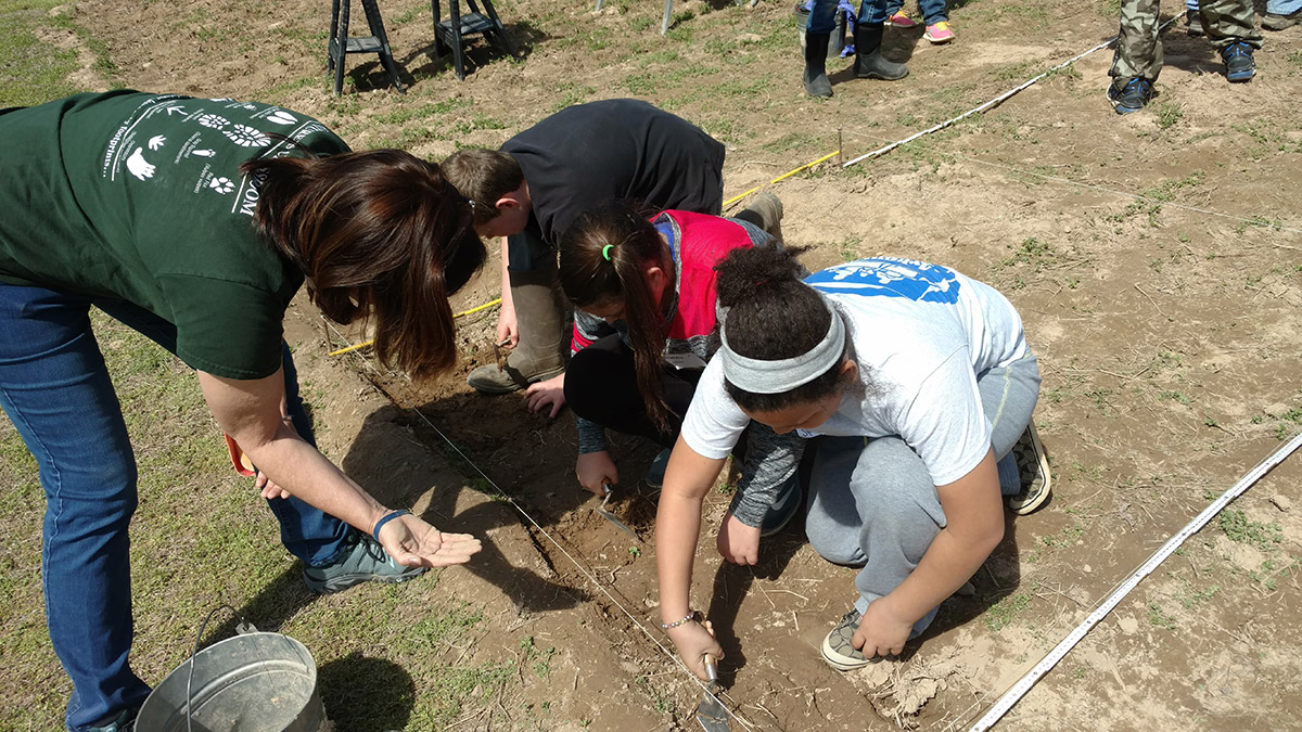 Project Dig students excavating.