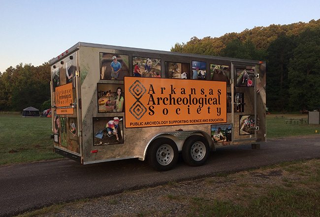 "New AAS trailer with decorative ""skin"" marking the location of the project camping ground."
