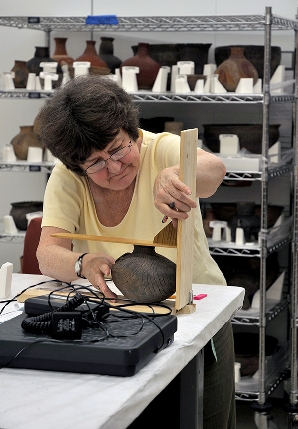 Dr. Ann Early (Arkansas State Archeologist) documenting Arkansas pottery collections at the National Museum of the American Indian collection facility in Suitland, MD.