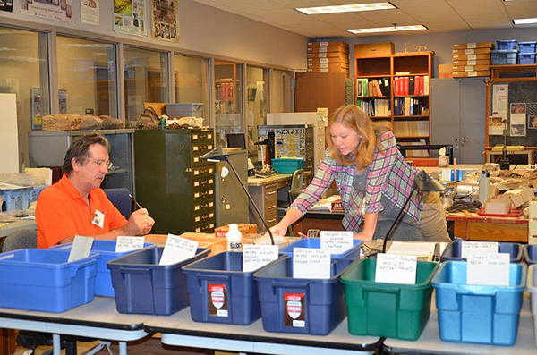 Volunteers Leanda Gavin and Steve Longacre assist in processing the Sargent Collection.