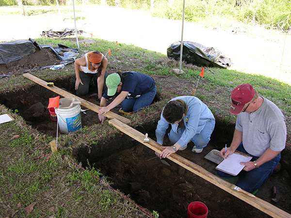 UAFS Introduction to Archeology students excavating in the backyard of the Drennen-Scott Historic Site.