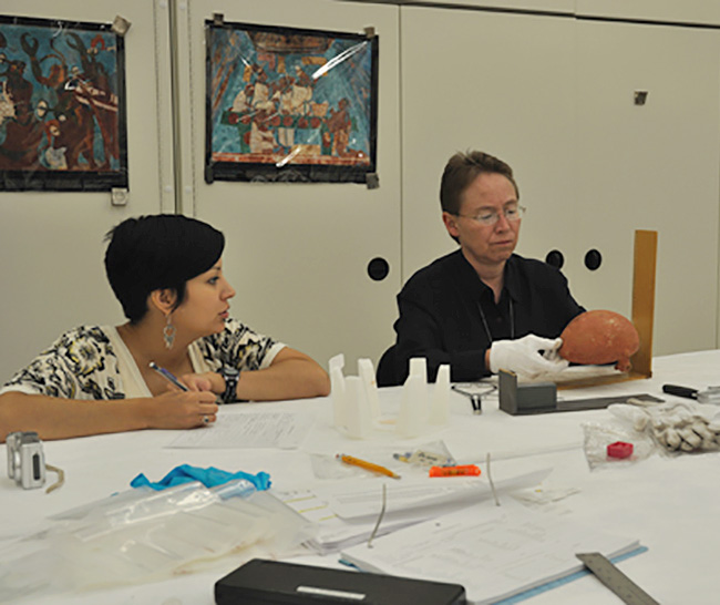 Osage Tribal Historic Preservation Officer Dr. Andrea Hunter (right) and assistant June Carpenter (left) documenting Carden Bottoms vessels at the National Museum of the American Indian.