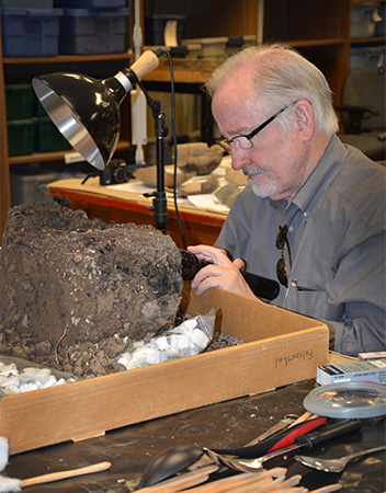 Professor David Stahle, a leading expert in tree-ring studies, examines the possible Parkin cross base.