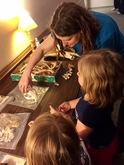 Michelle Rathgaber discusses animal bones with interested youngsters at the UAF Research Station..