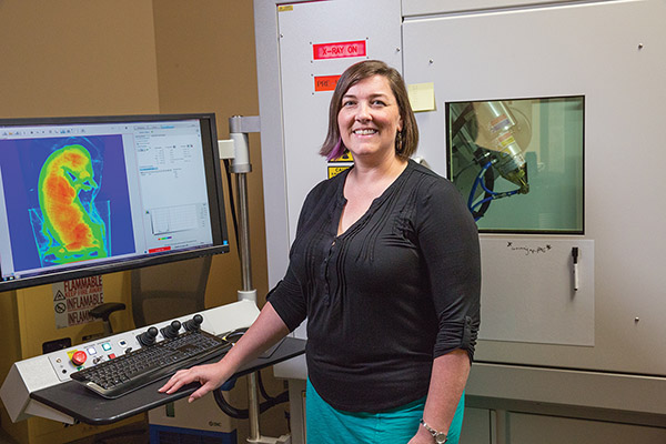 Figure 1. Dr. Claire Terhune (UA Anthropology Department) stands at the MicroCT console.